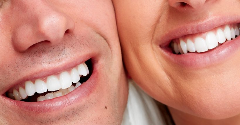 People smile. Happy loving couple healthy teeth.